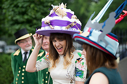 © London News Pictures. 20/06/2013. Ascot, UK.  Gabrielle Dirvanauskas (centre) wearing a hat in the shape of a cake at Ladies Day on day three of Royal Ascot at Ascot racecourse in Berkshire, on June 20, 2013.  The 5 day showcase event,  which is one of the highlights of the racing calendar, has been held at the famous Berkshire course since 1711 and tradition is a hallmark of the meeting. Top hats and tails remain compulsory in parts of the course. Photo credit should read: Ben Cawthra/LNP