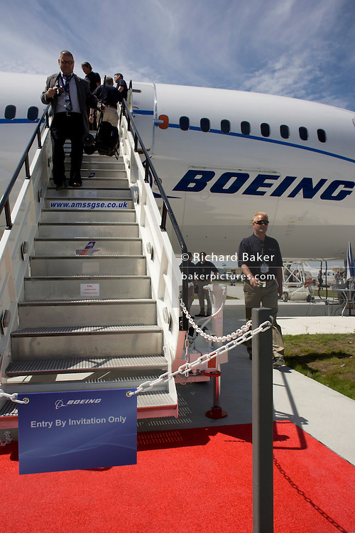 Media descend steps of the Boeing-manufactured 787 Dreamliner (N787BX) at the Farnborough Airshow.