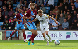 Matt Godden of Peterborough United in action with Charlie Goode of Scunthorpe United - Mandatory by-line: Joe Dent/JMP - 13/10/2018 - FOOTBALL - Glanford Park - Scunthorpe, England - Scunthorpe United v Peterborough United - Sky Bet League One