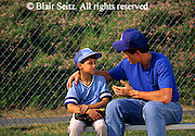 Outdoor recreation, Little League 12-year-old Boy and Father Work on Baseball Technique