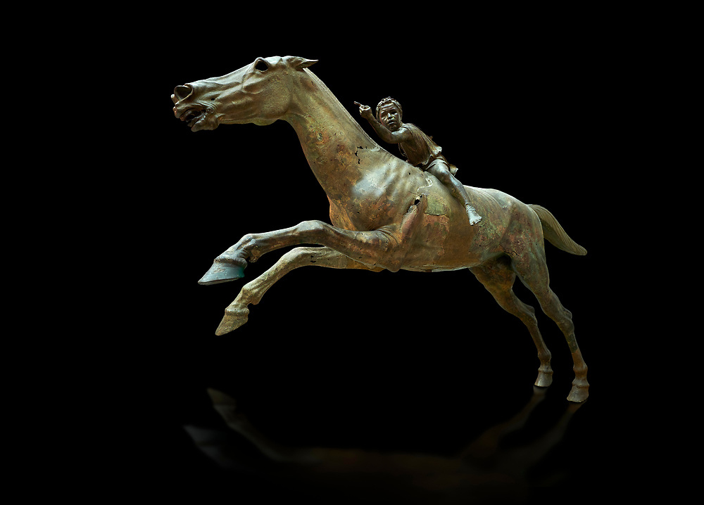 'Jockey of Artrmision' a Hellenistic bronze statue of a boy riding a horse. National Archaeological Museum Athens. Circa 140 BC. Cat No X 15177<br /> <br /> Retrieved in pieces from a shipwreck of Cape Artemision in Euboea. The young jockey holds a rein in his left hand and a whip in his right. His face has a passionate expression with furrowas on his face. The pieces of the Bronze sculpture were reassembled in 1971. .<br /> <br /> If you prefer to buy from our ALAMY STOCK LIBRARY page at https://www.alamy.com/portfolio/paul-williams-funkystock/greco-roman-sculptures.html . Type -    Athens    - into LOWER SEARCH WITHIN GALLERY box - Refine search by adding a subject, place, background colour, etc.<br /> <br /> Visit our ROMAN WORLD PHOTO COLLECTIONS for more photos to download or buy as wall art prints https://funkystock.photoshelter.com/gallery-collection/The-Romans-Art-Artefacts-Antiquities-Historic-Sites-Pictures-Images/C0000r2uLJJo9_s0