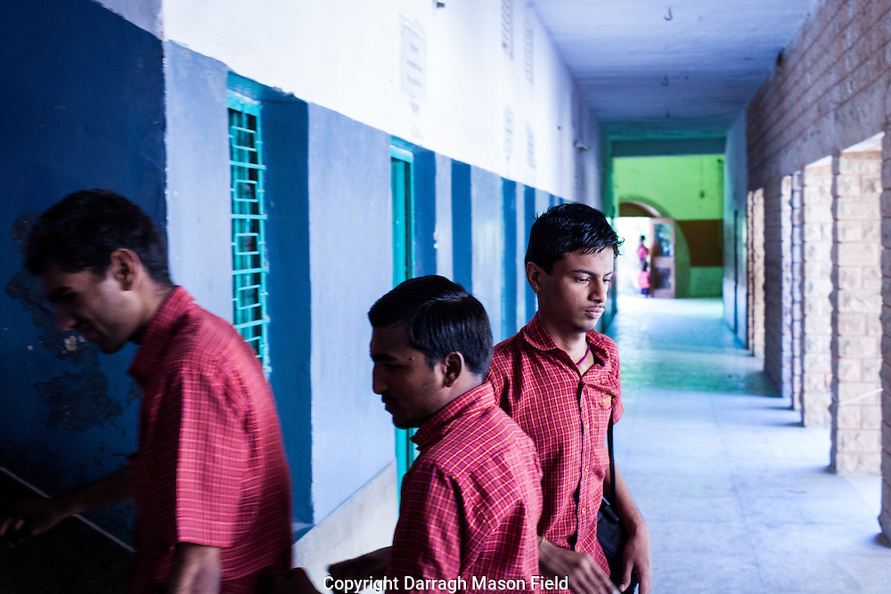 Students go from class to class.  The traffic is as noisy and excitable as any teenage school.