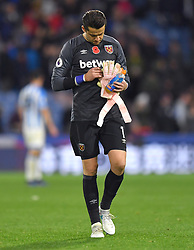 West Ham United goalkeeper Lukasz Fabianski leaves th epitch after the final whistle of the Premier League match at the John Smith's Stadium, Huddersfield.
