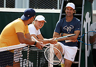 Iga Swiatek of Poland, Carlos Moya, coach of Rafael Nadal of Spain during practice ahead of the French Open 2021, a Grand Slam tennis tournament at Roland-Garros stadium on May 29, 2021 in Paris, France - Photo Jean Catuffe / ProSportsImages / DPPI