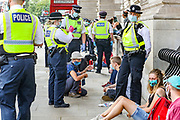 Police process the arrestees of Extinction Rebellion in Whitehall, central London on Wednesday, Sept 2, 2020. Environmental activist group XR enters its 2nd day of climate change demonstrations, which they began on the first week of September. (VX Photo/ Vudi Xhymshiti)
