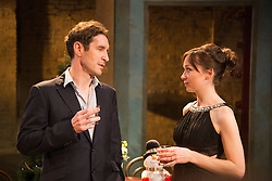 """© Licensed to London News Pictures. 07/04/2014. London, England. Pictured: Paul McGann as Vershinin and Emily Taaffe as Masha. The play """"Three Sisters"""" by Anton Chekhov, in a new version by Anya Reiss, opens at the Southwark Playhouse, London, with Paul McGann as Vershinin, Olivia Hallinan as Olga, Emily Taaffe as Masha and Holliday Grainger as Irina. Directed by Russel Bolam. Photo credit: Bettina Strenske/LNP"""