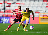 Lincoln City's Anthony Scully vies for possession with Oxford United's Sam Long<br /> <br /> Photographer Andrew Vaughan/CameraSport<br /> <br /> The EFL Sky Bet League One - Saturday 12th September  2020 - Lincoln City v Oxford United - LNER Stadium - Lincoln<br /> <br /> World Copyright © 2020 CameraSport. All rights reserved. 43 Linden Ave. Countesthorpe. Leicester. England. LE8 5PG - Tel: +44 (0) 116 277 4147 - admin@camerasport.com - www.camerasport.com - Lincoln City v Oxford United