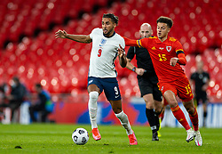 LONDON, ENGLAND - Thursday, October 8, 2020: England's Dominic Calvert-Lewin (L) and Wales' Ethan Ampadu during the International Friendly match between England and Wales at Wembley Stadium. The game was played behind closed doors due to the UK Government's social distancing laws prohibiting supporters from attending events inside stadiums as a result of the Coronavirus Pandemic. England won 3-0. (Pic by David Rawcliffe/Propaganda)
