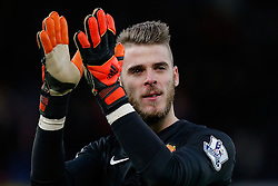 David De Gea of Manchester United applauds the away fans after the match finishes with a 1-1 draw - Photo mandatory by-line: Rogan Thomson/JMP - 07966 386802 - 01/01/2015 - SPORT - FOOTBALL - Stoke-on-Trent, England - Britannia Stadium - Stoke City v Manchester United - New Year's Day Football - Barclays Premier League.