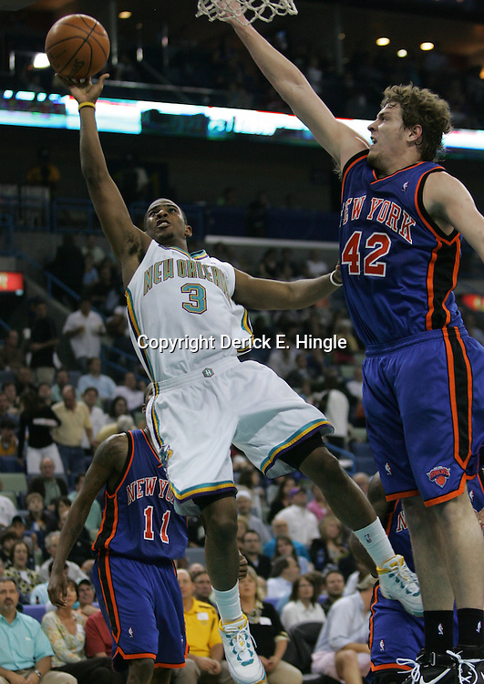 New Orleans Hornets guard Chris Paul #3 shoots past New York Knicks forward David Lee #42  in the third quarter of their NBA game on April 4, 2008 at the New Orleans Arena in New Orleans, Louisiana. New Orleans Hornets defeated the New York Knicks 118-110 and with the win clinched a NBA Playoff birth.