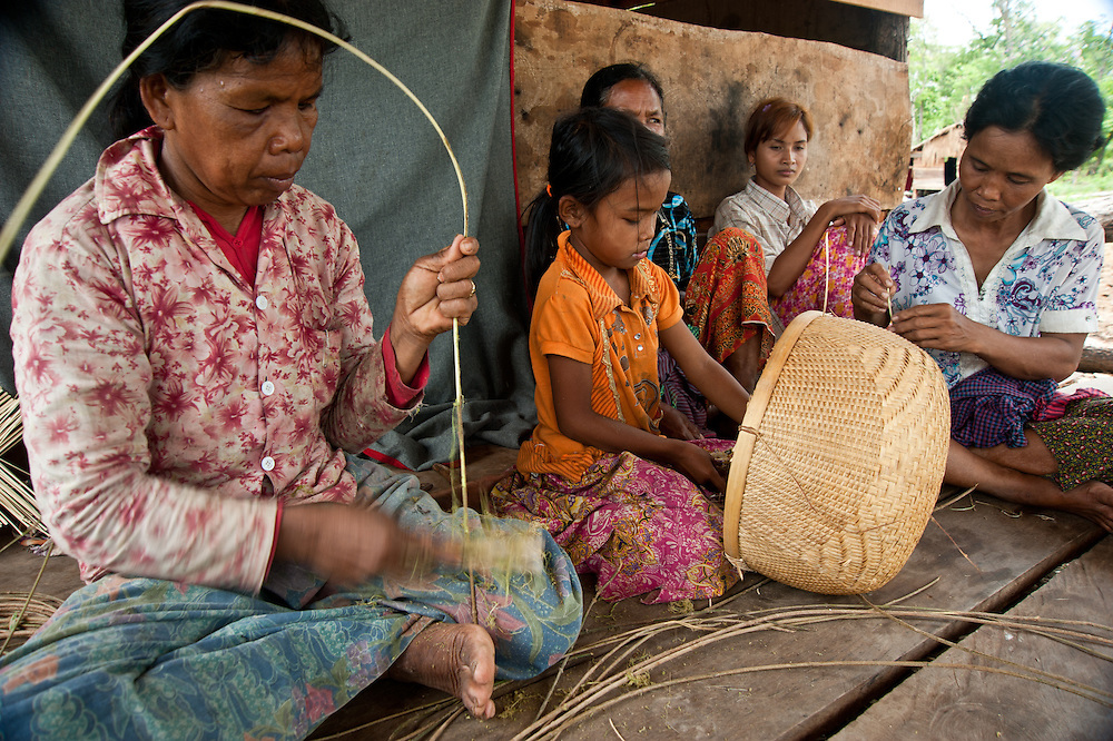Chheu Teal Korng village:.Remarkable how much CWS has accomplished here in less than a.year, because they are working with such a willing and committed local committee. CWS is also supporting micro loans and training for fish, produce and.mushroom farming. Nearly half of the families in this community are women-led households, mostly as a result of conflict.  Microloans can help women like Hing Ran (52), who had been taught as a girl how to make beautiful baskets out of bamboo.   A widow with one daughter, she did not have a home and was living with a niece when CWS partner helped her with a plan to market her baskets.  Her next dream:  a bicycle so that she can deliver her baskets to market.  Daughter is Sok Heng (9).
