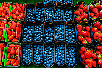 Strawberries and blueberries for sale at Rue Cler street market, Paris, France.