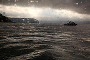 A fisherman cruises on Puget Sound near Whidbey Island during a moody, misty morning. (Erika Schultz / The Seattle Times)