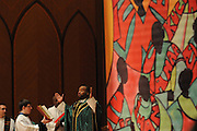 """Rev. David Jones leads Chicago Catholic School students in a final prayer during the 33rd Annual African American Heritage Month Mass at Holy Name Cathedral. This year's mass celebrates the the Nguzo Saba principle of Kuumba, or """"creativity"""" at Holy Name Cathedral."""