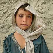 Portrait young student. The traditional life of the Wakhi people, in the Wakhan corridor, amongst the Pamir mountains.
