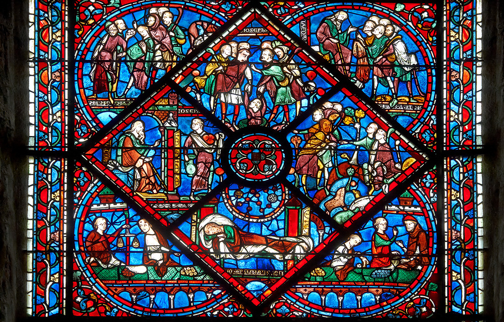 Medieval Windows of the Gothic Cathedral of Chartres, France- dedicated to Joseph the Patriach .  Central panel - bottom Joseph dreams the sun, moon and stars make obeisance to him (Gen.37:9)?left - Jacob sends Joseph to Shechem to take supplies to his brothers, right - Joseph's brothers tending their flocks in Dothan (Gen.37:18) , top - Joseph's brothers lower him into an old well (Gen.37:24) . A UNESCO World Heritage Site.