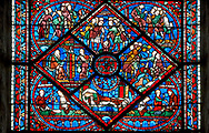 Medieval Windows of the Gothic Cathedral of Chartres, France- dedicated to Joseph the Patriach .  Central panel - bottom Joseph dreams the sun, moon and stars make obeisance to him (Gen.37:9)?left - Jacob sends Joseph to Shechem to take supplies to his brothers, right - Joseph's brothers tending their flocks in Dothan (Gen.37:18) , top - Joseph's brothers lower him into an old well (Gen.37:24) . A UNESCO World Heritage Site. .<br /> <br /> Visit our MEDIEVAL ART PHOTO COLLECTIONS for more   photos  to download or buy as prints https://funkystock.photoshelter.com/gallery-collection/Medieval-Middle-Ages-Art-Artefacts-Antiquities-Pictures-Images-of/C0000YpKXiAHnG2k