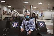 Atlanta, GA, USA - January 23, 2021: David Elliott, a pilot for a FedEx contractor, waits inside the Atlanta airport for a flight home to Florida.