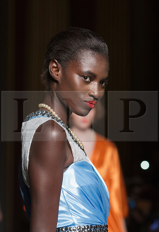 """© Licensed to London News Pictures. 15/09/2012. London, England. Singaporean Fashion Designer Ashley Isham shows his collection at a catwalk show at Goldsmiths Hall in the City of London. The Off-Schedule show is part of """"My Beautiful Fashion"""" during London Fashion Week. Photo credit: Bettina Strenske/LNP"""