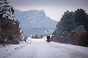 A black Amish buggy and horse travel south on CO 69 on a snowy March morning near Hillside, CO. Presented at Art for the Sangres, double matted in a 16x22 wood frame: $325.