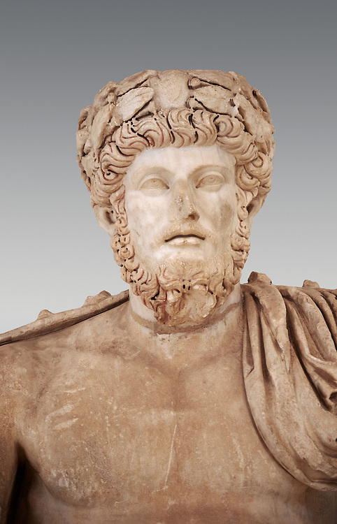 Roman sculpture of the Emperor Lucius Verus, excavated from Bulla Regia Theatre, sculpted circa 161-169 AD. The Bardo National Museum, Tunis.   Against a grey background. .<br /> <br /> If you prefer to buy from our ALAMY STOCK LIBRARY page at https://www.alamy.com/portfolio/paul-williams-funkystock/greco-roman-sculptures.html . Type -    BARDO    - into LOWER SEARCH WITHIN GALLERY box - Refine search by adding a subject, place, background colour, museum etc.<br /> <br /> Visit our CLASSICAL WORLD HISTORIC SITES PHOTO COLLECTIONS for more photos to download or buy as wall art prints https://funkystock.photoshelter.com/gallery-collection/The-Romans-Art-Artefacts-Antiquities-Historic-Sites-Pictures-Images/C0000r2uLJJo9_s0c