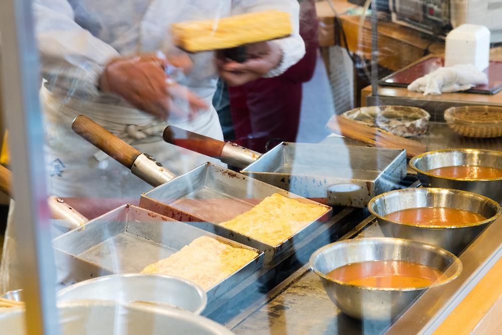 Chef making an egg type savoury cake.