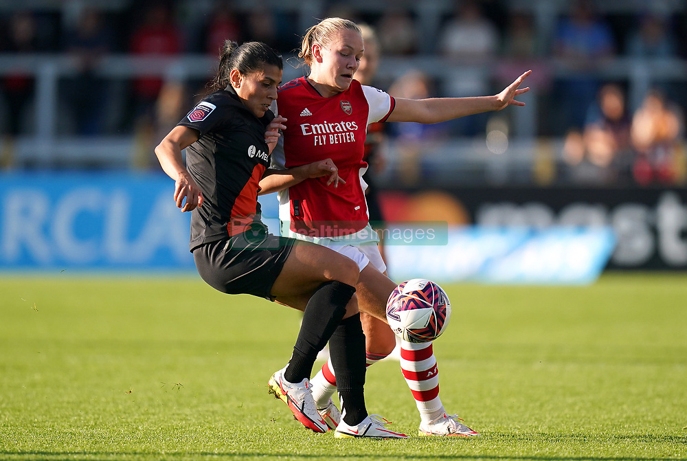 Everton's Kenza Dali (left) and Arsenal's Frida Maanum battle for the ball during the FA Women's Super League match at Meadow Park, Borehamwood. Picture date: Sunday October 10, 2021.