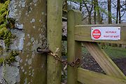 A No Entry, No Right of Way warning sign on a locked farmer's gate in the Yorkshire Dales National Park, on 13th April 2017, in Horton in Ribblesdale, Yorkshire, England.