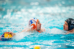 Kjeld Veenhuis of the Netherlands in action against Charles Canonne of France during the Olympic qualifying tournament. The Dutch water polo players are on the hunt for a starting ticket for the Olympic Games on February 17, 2021 in Rotterdam