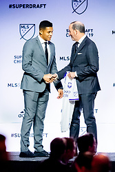 January 11, 2019 - Chicago, IL, U.S. - CHICAGO, IL - JANUARY 11: Santiago Patino poses for a photo with MLS commissioner Don Garber after being selected as the number three overall pick to Orlando City FC in the first round of the MLS SuperDraft on January 11, 2019, at McCormick Place in Chicago, IL. (Photo by Patrick Gorski/Icon Sportswire) (Credit Image: © Patrick Gorski/Icon SMI via ZUMA Press)