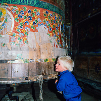 4-year old Ben Wiltsie turns a huge prayer wheel in the gompa (temple) in Namche Bazar in the Khumbu region of Nepal 1986.