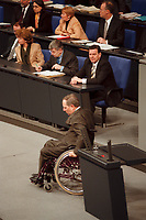 20 JAN 2000, BERLIN/GERMANY:<br /> Wolfgang Schäuble, CDU Vorsitzender und CDU/CSU Fraktionsvorsitzender, nach seiner Rede, im Hintergrund: Joschka Fischer und Gerhard Schröder, Debatte zur CDU Spendenaffäre, Plenum, Deutscher Bundestag<br /> Wolfgang Schaeuble, Chairman of the Christian Democratic Union and the CDU/CSU parliamentary group, after his speech, in the background: Joschka Fischer and Gerhard Schroeder, debate about the affair of secret donations to the CDU<br /> IMAGE: 20000120-01/03-01