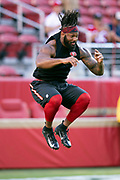 San Francisco 49ers linebacker Dekoda Watson (97) jumps in the air as he warms up before the NFL week 9 regular season football game against the Oakland Raiders on Thursday, Nov. 1, 2018 in Santa Clara, Calif. The 49ers won the game 34-3. (©Paul Anthony Spinelli)