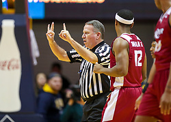 Nov 28, 2018; Morgantown, WV, USA; Official Gary Maxwell makes a foul call after an altercation between players of both the West Virginia Mountaineers and the Rider Broncs during the first half at WVU Coliseum. Mandatory Credit: Ben Queen-USA TODAY Sports