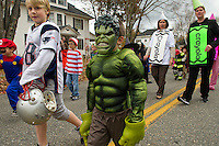 """Andrew Smith walks with his buddy """"The Incredible Hulk"""" David Jean during Pleasant Street School's Halloween parade through the streets of Laconia Wednesday afternoon.  (Karen Bobotas/for the Laconia Daily Sun)"""