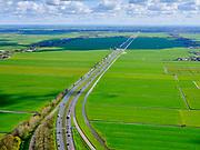 Nederland, Noord-Holland, Wijdewormer, 07-05-2021; Polder Wijdewormer, doorsneden door autosnelweg A7 gezien naar Purmerend.<br /> Polder Wijdewormer, bisected by the A7 motorway, seen to Purmerend.<br /> luchtfoto (toeslag op standaard tarieven);<br /> aerial photo (additional fee required)<br /> copyright © 2021 foto/photo Siebe Swart.