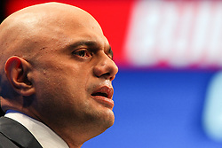 © Licensed to London News Pictures. 05/10/2021. Manchester, UK.  Secretary of State for Health and Social Care Sajid Javid addresses the Conservative Party Conference on Tuesday. The annual Conservative Party Conference has returned to Manchester this year after being held online in 2020. Photo credit: Adam Vaughan/LNP