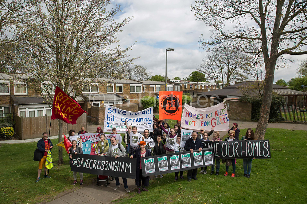 Tenants, residents and Save Cressingham Gardens campaigners during the Reclaim Brixton Demonstration, an anti gentrification demonstration on 25th April 2015 in South London, United Kingdom. Cressingham Gardens is a council garden estate, located on the southern edge of Brockwell Park. It comprises of 306 dwellings and built to the design of Lambeth Borough Council architect Edward Hollamby in the early 1970s. In 2012, Lambeth Council proposed regeneration of the estate, a decision highly opposed by many residents. Since the announcement, the highly motivated campaign group Save Cressingham Gardens has been active.