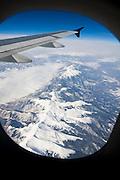 The Colorado Rocky Mountains seen through an airplane window.