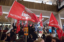 London, UK. 29 October, 2019. Students join UCL security officers, cleaners and porters outsourced via Axis and Sodexo and belonging to the Independent Workers of Great Britain (IWGB) trade union at a protest inside the university to call for decent terms and conditions and an end to outsourcing, discrimination and 'precarity and mismanagement'. The terms and conditions of outsourced workers at UCL are considerably worse than for comparable UCL employees, with no occupational sick pay and reduced annual leave entitlement and pensions.
