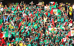 Mexico supporters cheers prior to the kick-off of the Group A first round 2010 FIFA World Cup South Africa match between South Africa and Mexico at Soccer City Stadium on June 11, 2010 in Johannesburg, South Africa.  (Photo by Vid Ponikvar / Sportida)