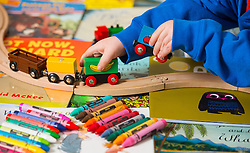 File photo dated 24/01/15 of a toddler playing with toys, as one in six families who have applied for a mortgage in the last 10 years say they have been offered a smaller loan or even rejected because of their childcare costs.