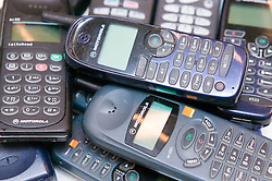 Pile of old mobile phones waiting to be recycled,