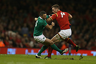 George North of Wales is tackled by Rob Kearney of Ireland.RBS Six Nations 2017 international rugby, Wales v Ireland at the Principality Stadium in Cardiff , South Wales on Friday 10th March 2017.  pic by Andrew Orchard, Andrew Orchard sports photography