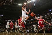 Dec. 07, 2010; Charlottesville, VA, USA;  Virginia Cavaliers forward Will Regan (4) is fouled by Radford Highlanders guard Evan Faulkner (2) during the game at the John Paul Jones Arena. Virginia won 54-44. Mandatory Credit: Andrew Shurtleff