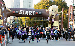 CHICAGO, Oct. 30, 2017  Participants run through the starting point at Grant Park, Chicago, the United States, Oct. 29, 2017. 30,000 runners participated the 10th Chicago Hot Chocolate 15K/5K Race starting at Grant Park. Finishers are treated to goody bags, a mug of hot chocolate, and treats on top of a huge celebration.  yk) (Credit Image: © Wangping/Xinhua via ZUMA Wire)