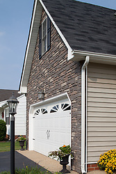 6370_Yellow_Rose stone siding exterior of house garage