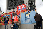 May Day march and rally at Trafalgar Square, May 1st, 2010 Trades Union Banners on Nelson's column