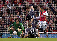 Photo: Olly Greenwood.<br />Arsenal v Bolton Wanderers. The FA Cup. 28/01/2007. Arsenal's Manuel Almunia saves from Bolton's Kevin Davies