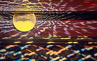Surreal light reflections from a turning mirror-ball paint the ceiling at the Admiral Theater in Bremerton, WA, USA